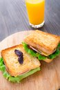Sandwich with ham cheese tomatoes and lettuce salad on toasted bread Royalty Free Stock Photo