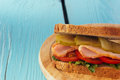 Sandwich with ham, cucumber, tomato closeup Royalty Free Stock Photo