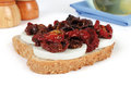 Sandwich of mozzarella and dried tomatoes on white background Royalty Free Stock Photo
