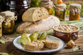 Sandwich in the pantry from the winter stocks on old wooden table Stock Images