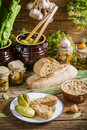 Sandwich with pickles and lard in the pantry on old wooden table Stock Photo