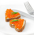 Sandwich with red caviar in the form of a heart Stock Photos