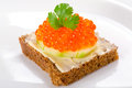 Sandwich with red caviar on the plate Royalty Free Stock Photos