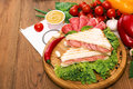 Sandwich with salami. Lettuce, cherry tomatoes, mustard, basil, Royalty Free Stock Photo