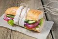 Sandwich with salami tomato and lettuce cucumber Stock Photography