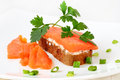 Sandwich with salmon and parsley on a white plate Stock Image