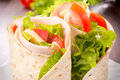Sandwich wrap tasty tortilla with turkey and vegetables Royalty Free Stock Photography