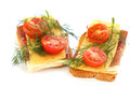 Sandwiches with bacon cheese cherry tomato and dill isolated on white background Stock Photo