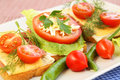 Sandwiches with bacon cheese cherry tomato and dill on plate Royalty Free Stock Image