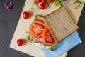 Sandwiches bacon lettuce broken egg salad and tomato with fresh tomato and lettuce on the wooden board Stock Images