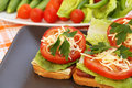 Sandwiches with bacon lettuce tomato and cheese on plate Stock Photography