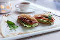 Sandwiches a delicious lunch of two with croissants fresh bacon cucumber lettuce and tomato excellent choice for a healthy diet Stock Photography