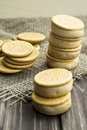 Sandwiches made from cookies and ice cream with condensed milk on a table with burlap Royalty Free Stock Photo