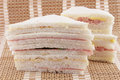 Sandwiches on a mat exquisite white bread stacked close up view Stock Photography