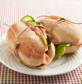 Sandwiches with mortadella and vegetables on plate Royalty Free Stock Images