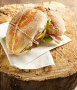 Sandwiches with mortadella and vegetables on wooden background Royalty Free Stock Photo