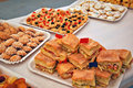 Sandwiches and pastries for a party Royalty Free Stock Photos
