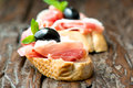 Sandwiches with prosciutto olive on wooden old table horizontal sandwich Royalty Free Stock Image