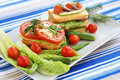 Sandwiches with salami cheese cherry tomato and herbs on plate Stock Images