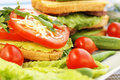Sandwiches with salami cheese cherry tomato and parsleyl on plate Stock Photo