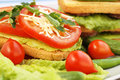 Sandwiches with salami cheese cherry tomato and parsleyl on plate Stock Images