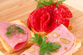 Sandwiches with salami and mortadella on wooden board Royalty Free Stock Photos