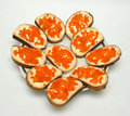 Sandwiches with salmon caviar on a platter. Royalty Free Stock Photography