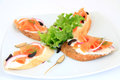 Sandwiches with salmon decoration Stock Images