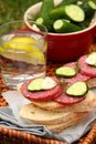 Sandwiches with smoked sausage and homemade salted cucumbers fresh in the bowl Royalty Free Stock Photos