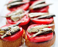 Sandwiches with sprats and tomatoes Royalty Free Stock Photography