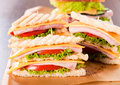 Sandwiches three club on the table Royalty Free Stock Image