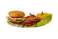 Sandwiches to a plate on the isolated background Royalty Free Stock Photo