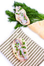 Sandwiches of white bread with herring onions and herbs on background Stock Image