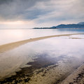 Sandy beach and calm waters at sunset in southern croatia dalmatia Royalty Free Stock Photo