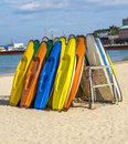 Sandy beach, color kayaks based on stand, in background beautifu