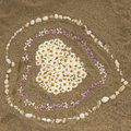 Sandy beach with heart from flowers, Corsica Royalty Free Stock Photo
