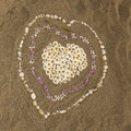 Sandy beach with hearts from flowers, Corsica, France Royalty Free Stock Photo