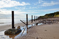 Sandy beach with a line of posts. Royalty Free Stock Images