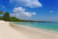 Sandy beach on mahe island seychelles with turquoise water Royalty Free Stock Photos