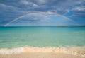 Sandy beach and rainbow Royalty Free Stock Photo