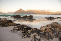 Sandy beach with rocks on warm day near cape town south africa Stock Image