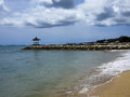 Sandy beach warm and on the island of bali attracts tourists Royalty Free Stock Photo