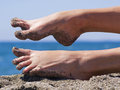 Sandy crazy woman toes on the beach moving and relaxing Stock Image