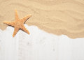 Sandy decking sand on wooden with starfish Royalty Free Stock Image