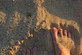 Sandy feet on the beach Royalty Free Stock Photo
