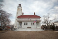 Sandy hook lighthouse and lightkeepers house a view of the at fort hancock on in new jersey this is the oldest working Royalty Free Stock Photography