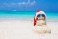 Sandy snowman with red Santa Hat on white Royalty Free Stock Photo