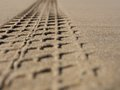 Sandy tread selective focus of a mark in sand Royalty Free Stock Photo