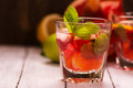 Sangria with citrus fruits, ice cubes and mint leaves Royalty Free Stock Photo