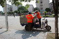 Sanitation workers are working in guilin the picking up trash on the street Stock Photo